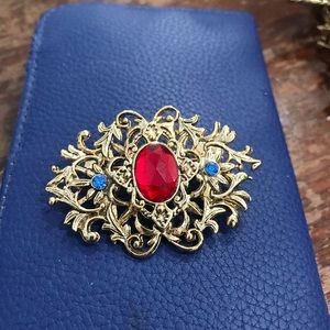 Red center stone blue rhinestone on sides pin